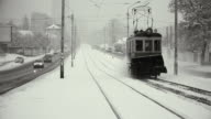 Old tram clean rails from snow. video