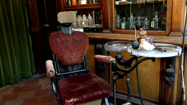 Old Victorian dentist room with original chair and scary looking instruments video