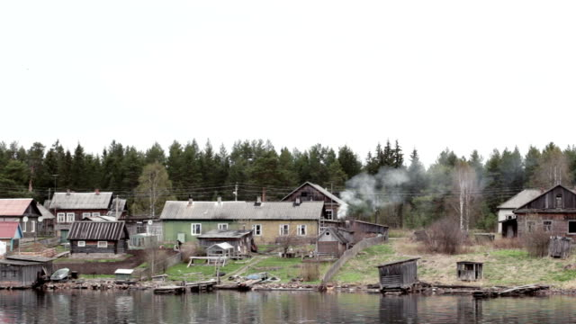 Old village houses on the river Volga in Russia. video