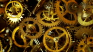 Old watch gears background with appearing new ones video
