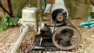 Old water pump, close-up to belt and wheel. video