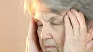 Old woman aged 80s suffers from headaches video