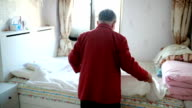 Old woman in the bedroom video