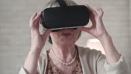 Old Woman Jumping in VR Glasses video