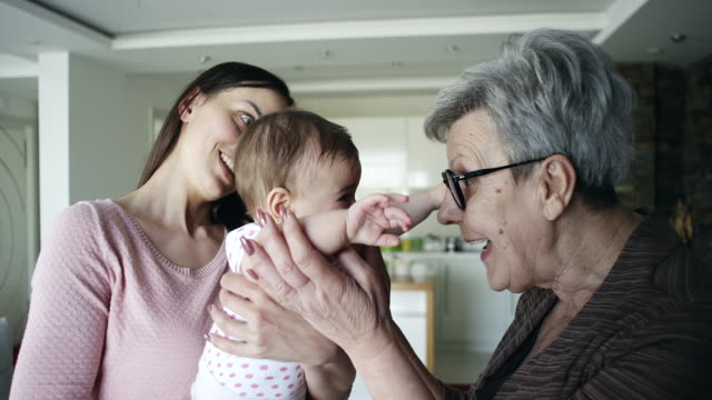 Old woman meeting her great granddaughter video