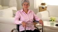 Old woman sitting in wheelchair video