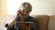 Old woman talking on a mobile phone video