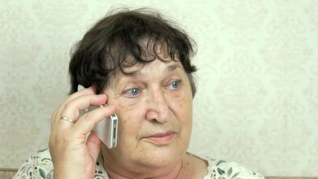 Old woman talking on the mobile phone video