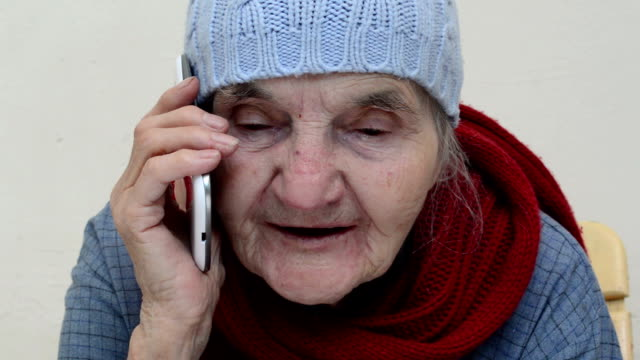 Old woman using smartphone video