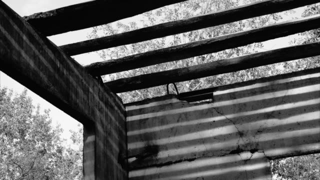 Old wood rood of ruined home. Fast sun shadows lights movements time lapse. video