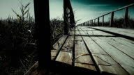 Old wooden bridge in mountains horizontal dolly shot. Close up video