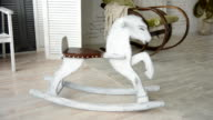 Old wooden rocking horse video