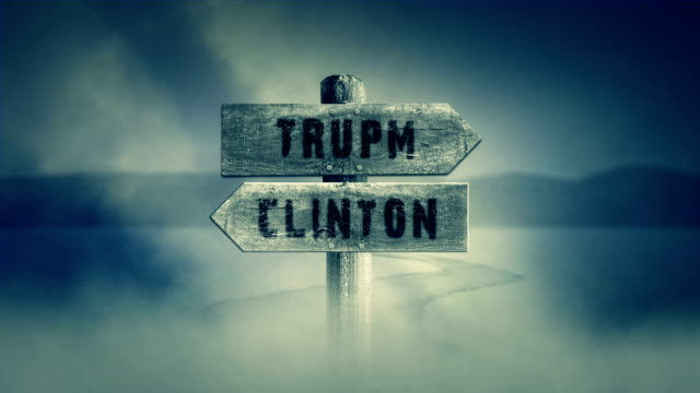 Old Wooden Sign on a Middle of a Cross Road With the Words Trump or Clinton video