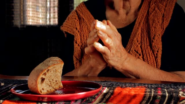 Old wrinkled farmers hands pray to God for the food video