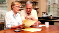 Older couple paying their bills video