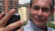 Older Man Taking Selfy video