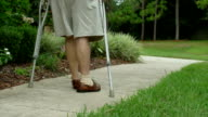 Older Man Walking With Crutches video