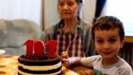 Oldest woman celebrates her 101s. Her grand-son is near video