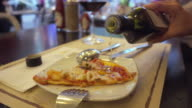 olive oil and pizza slice video