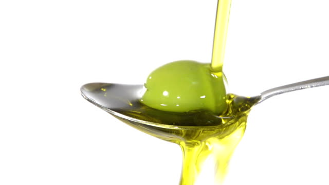 Olive oil on a spoon video