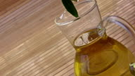 Olives and bottle with olive oil video
