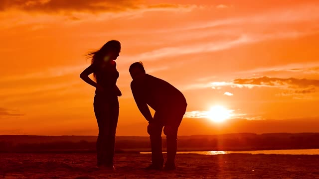 on sunset background girl and man slow motion video video