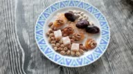 On the plate are oriental sweets. video