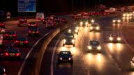 Oncoming motorway headlights at night video