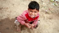 One Cheerful Rural Indian Boy looking at camera video