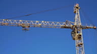One construction crane working in the blue sky video