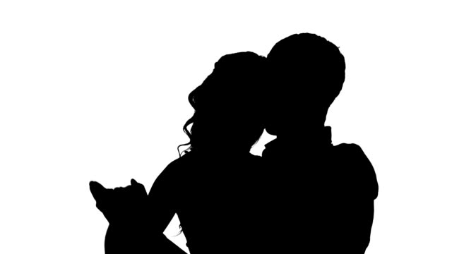 one couple man and woman dancing rock in studio silhouette isolated on white background, Slow motion video