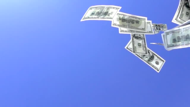 One hundred dollar bills flying in slow motion. video