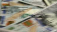 One Hundred Dollar Bills Rotating on Tray video