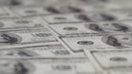 One hundred dollars pile as background video