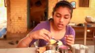 One Indian teenager girl enjoying her Konkani Food Meal video