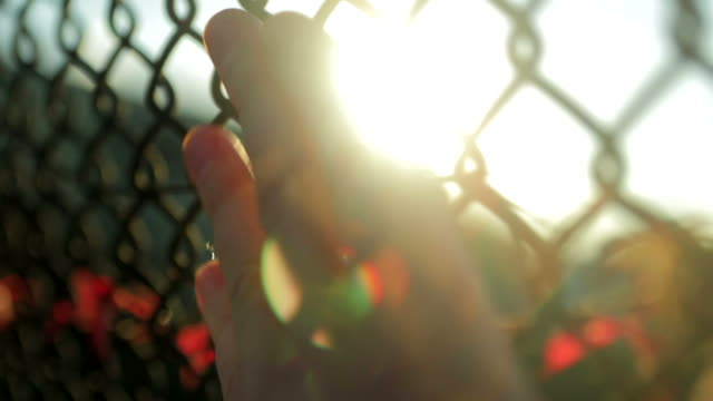 One person Hand on fence walking slow motion video