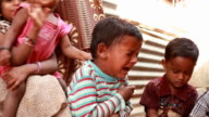 One rural Indian boy crying among the group of children video