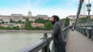 One single man looking Budapest Castle view, Chain Bridge video