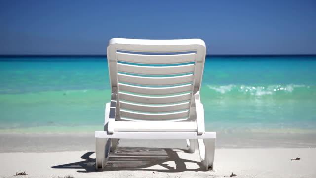 One sunbed on tropical calm beach video
