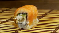One Sushi on a Bamboo Mat Rotates video