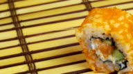One Sushi Roll on a Bamboo Mat Rotates video