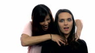 One women trying to strangle another on white background video