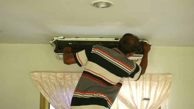 one worker repairing air conditioner video