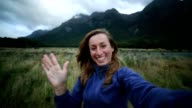 One young woman hiking takes selfie video