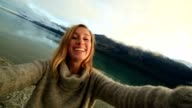 One young woman in nature takes selfie portrait video