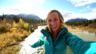 One Young woman taking selfie portrait in nature video