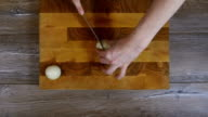 Onions sliced into pieces with a knife video