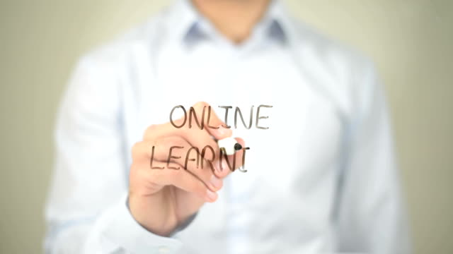 Online Learning , Man writing on transparent screen video