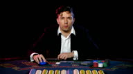 Online poker player plays in a casino. Close up video