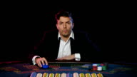 Online poker player with cards and chips at casino. Close up video